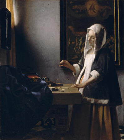 Woman holding a balance by Vermeer.